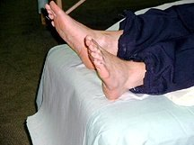 A rescue worker receives foot acupuncture.