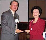 Doreen Chen with award and Gene Bruno. - Copyright – Stock Photo / Register Mark