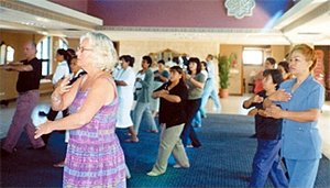Pamela Brady leads a qigong session from last year's meeting. - Copyright – Stock Photo / Register Mark