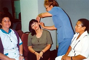 Participating doctors and nurses practice the NADA five-needle protocol. - Copyright – Stock Photo / Register Mark