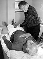 Bob Duggan and other volunteer acupuncturists provide individual full-body treatment. - Copyright – Stock Photo / Register Mark