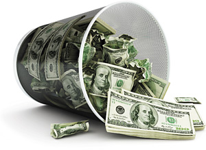 Money in trash can - Copyright – Stock Photo / Register Mark