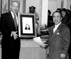 Jack Knight presents an engraved plaque to Emeritus Shuji Goto. - Copyright – Stock Photo / Register Mark