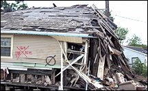 Flood damaged home. - Copyright – Stock Photo / Register Mark