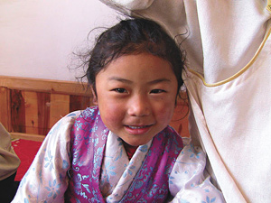 Tibetan girl - Copyright – Stock Photo / Register Mark